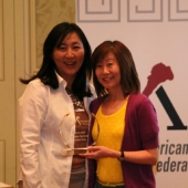 At the awards event, Alice Lee, Vice President of Research at KSCI (LA-18), (left) presented the 2012 3AF Media Partner of the Year award to Lisa Yokota, Director of Marketing at KTSF.