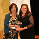 Genny Hom-Franzen, 3AF Executive Director, (left) presented the 2012 3AF New Marketer of the Year Award to Puget Sound Energy. Accepting the award from PSE was Megan O'Brien, Energy Efficiency Communications Manager.