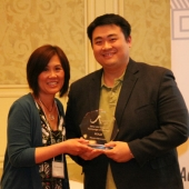 Admerasia received the Gold award (first place) for Creative Campaign of the Year. Standing left to right are Genny Hom-Franzen, 3AF Executive Director, and Tommy Ng, General Manager, Admerasia.